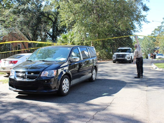 A hearse leaves a home on Buena Vista Drive where Tallahassee