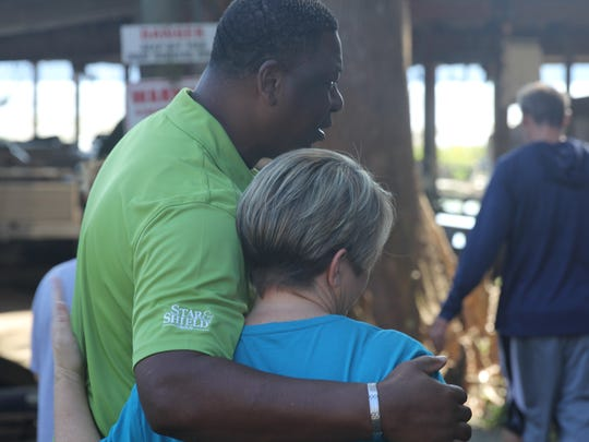 Sheriff Morris Young hugs a family member of the 10-year-old