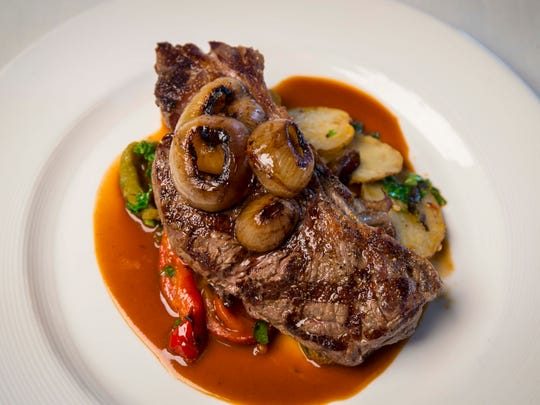 Grass-fed steak with winter vegetables at HoQ on Thursday, Nov. 2, 2017. The East Village restaurant is celebrating five years in Des Moines.