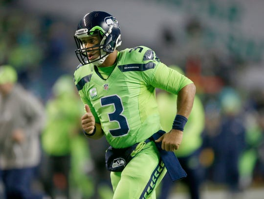 "Russell Wilson dons Seattle's ""Action Green"" Color"