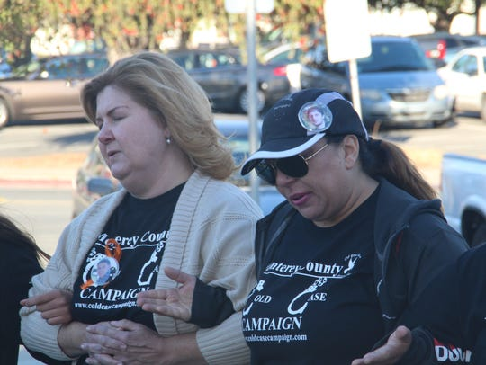 Melissa Garner, 44, and Misty Arias, 47, hold arms