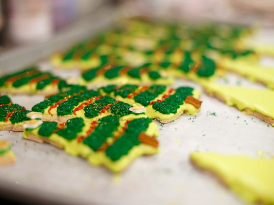 Finished and unfinished Christmas cookies rest on a
