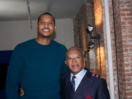 "Carmelo Anthony (left) and Henry Louis Gates, Jr. on the set of ""Finding Your Roots."""