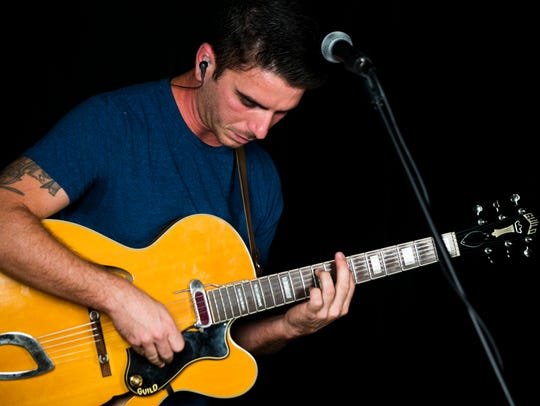 Guitarist and vocalist Taylor Freydberg performs with