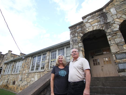 Brenda and George Maser stand outside the old Mars