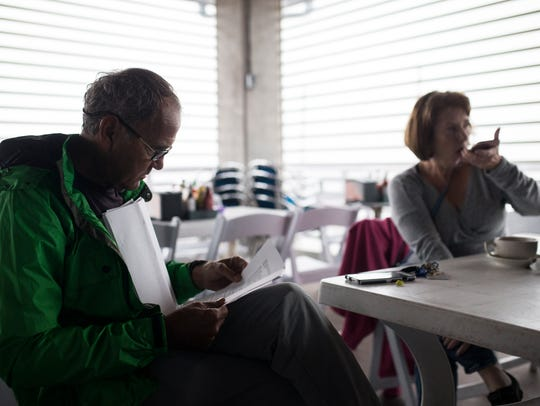 Dr. John Fletemeyer, Left, and Dr. Angela Moore read over the credentials of the expert uses in the Laura Day trial, Wednesday, Nov. 9, 2017, at Bob Hall Pier.