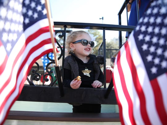Susanna Pietrzyk, 3, stands on a float on Monroe Street