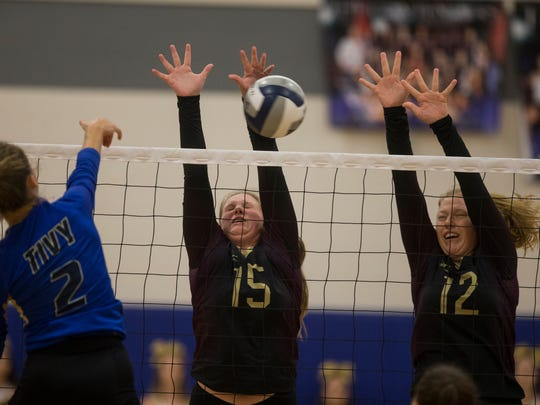 Tuloso Midway's Hadleigh Hight, left, and Kelsi Luckenbach block a spike from Kerrville Tivy's Kathryn Stieler during the regional final match on Saturday, Nov. 11, 2017.