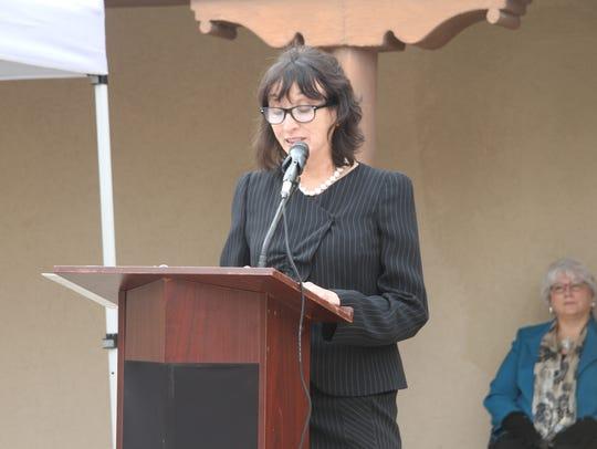 Celia Ruiz speaks at the Veterans Day celebration Saturday,