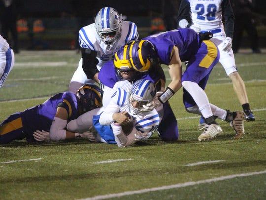 Whitefish Bay quarterback Cade Garcia fights for tough yards against Eisenhower on Nov. 10.