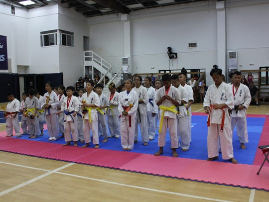 In this Nov. 11, 2017, file photo, youths stand ready at World Karate Organization Shinkyokushinkai Karate Guam.