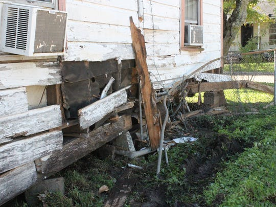 A Houston Street home was damaged Tuesday morning when