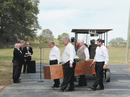 Pallbearers carry the remains of Tidence Lane to his new resting place at First Baptist Church, Whitesburg. Lane is regarded as the first pastor of any church of any denomination in the state of Tennessee.  FBC, Whitesburg, formerly was known as Bent Creek Baptist Church, which Lane founded in 1785. In the foreground are, from left, Allen Payne, pastor, FBC, Whitesburg; Randy C. Davis, president and executive director, Tennessee Baptist Mission Board; and Richard Long, pastor, Brown Springs Baptist Church, Mosheim, and a direct descendant of Tidence Lane.