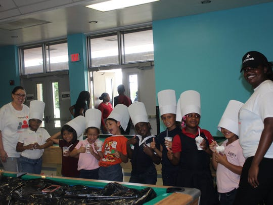 Members of the Boys & Girls Clubs of St. Lucie County got to make and eat a delicious fruit parfait while wearing a chef's hat provided by Aramark.