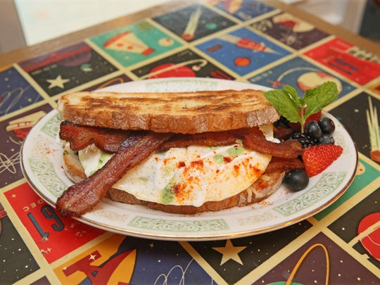 """Sabrosa Cafe's plate-sized breakfast sandwich, the SBSBBS, which stands for """"spicy brown sugar bourbon bacon sandwich."""""""
