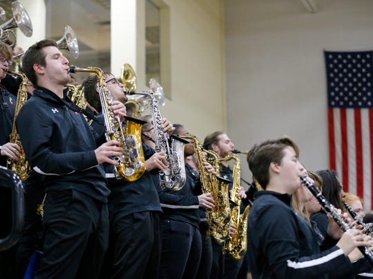 The UC Pep Band performs during a time out in the fourth quarter of the NCAA women's basketball game between the Cincinnati Bearcats and the Southeastern Louisiana Lions at St. Ursula Academy in the East Walnut Hills neighborhood of Cincinnati on Wednesday, Nov. 15, 2017.