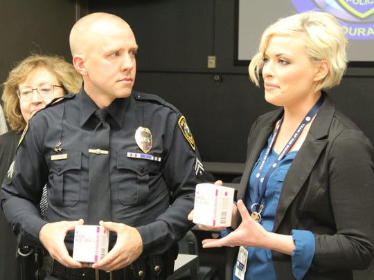 Officer Clint Houston of the Great Falls Police Department (left) and Nikki Phillips, a nurse and office manager of Outpatient Specialty Clinics speak of the importance of the opioid overdose reversal drug, Narcan