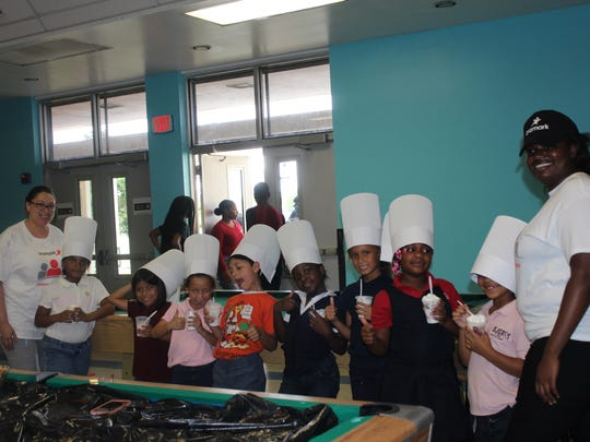 Club members enjoyed their parfait, which Aramark employees taught them to make.