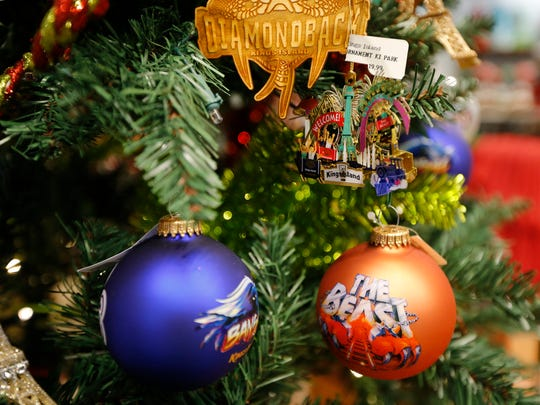 Christmas merchandise is put on display in the gift shop at Kings Island in Mason, Ohio, on Thursday, Nov. 16, 2017. Kings Island's WinterFest will run from Black Friday through the end of the year.