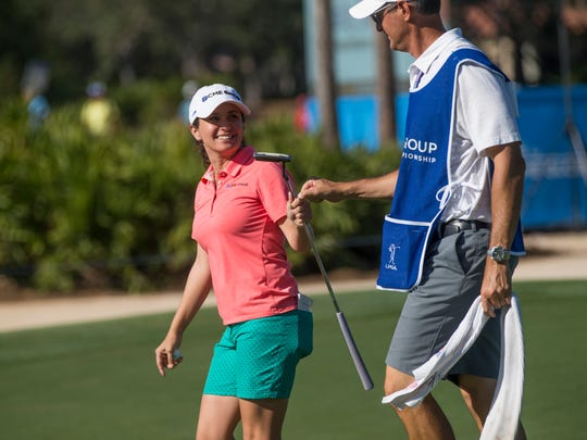 Naples local and LPGA tour pro Mo Martin bumps fist with her caddie after sinking a putt on the eighth hole during the first round of the CME Group Tour Championship at Tiburon Golf Club Thursday, Nov. 16, 2017 in Naples.