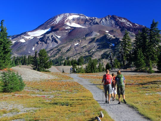 Hikers head into the shadow of South Sister, Oregon's third-tallest mountain.