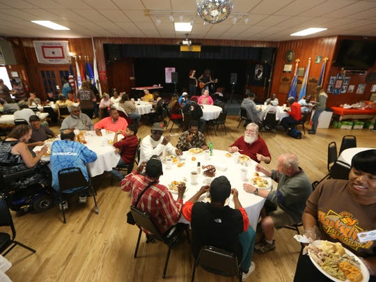 Volunteers serve turkey and all the trimmings during a community Thanksgiving celebration last year at American Legion Hall Post 13.