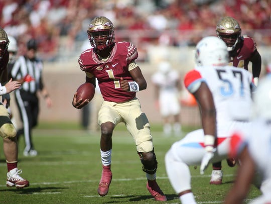 FSU quarterback James Blackman steals a look down the