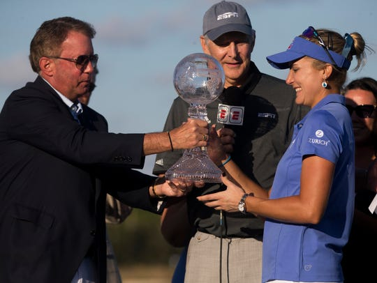LPGA Tour pro Lexi Thompson is awarded the $1 million CME Globe season trophy after the final round of the CME Group Tour Championship at Tiburón Golf Club on Sunday in Naples.