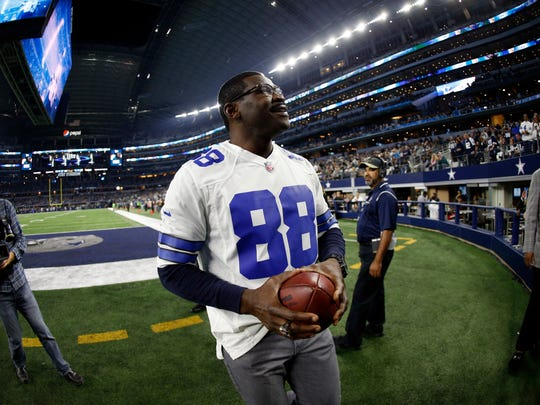 Former Dallas Cowboys player Michael Irvin participates in a pregame ceremony honoring the Super Bowl XXVII team before an NFL football game against the Philadelphia Eagles on Sunday, Nov. 19, 2017, in Arlington, Texas.