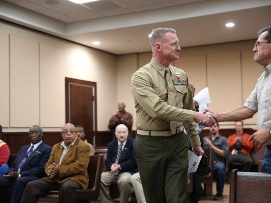 Keynote speaker U.S. Marine Corps Col. Bradley Close (left) shakes hands with graduating Marine Corps veteran Thomas Tate during the fifth Leon County Veterans Treatment Court Graduation at the Leon County Courthouse Monday.
