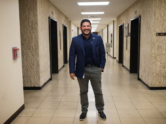 Nueces County District Attorney Mark Gonzalez laughs in the hallway outside his office, Tuesday, Nov. 21, 2017, at Nueces County Court House. Gonzalez is a dedicated Dallas Cowboys fan and wore a jersey during his informal swearing-in ceremony.