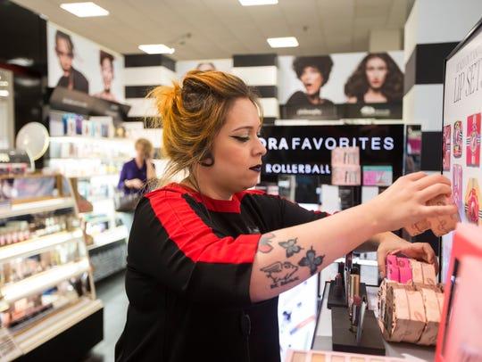 Beauty Manager of Sephora Trisha Alaniz organizes products