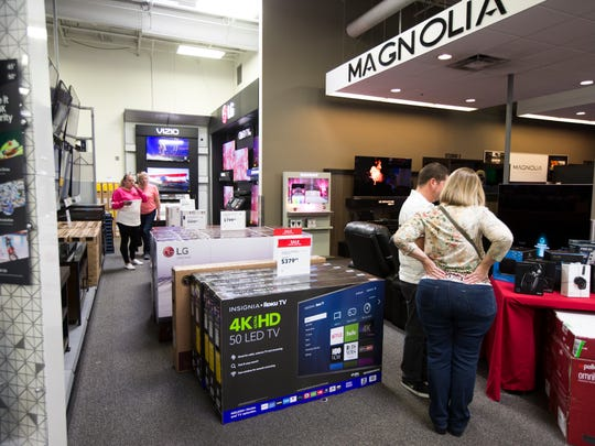 Customers shop for the upcoming holidays Tuesday, Nov. 21, 2017 at Best Buy.