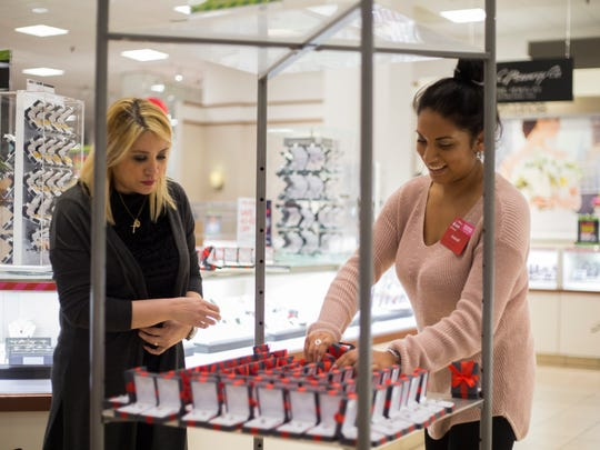 JC Penney sales associates Baharen Davies (left) and Araceli Acosta prepare jewelry for the upcoming Black Friday sales, Tuesday, Nov. 21, 2017, at JC Penney in LaPalmera mall.