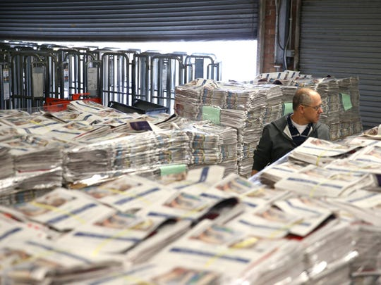 Packaging Manager Ken Rice is dwarfed by stacks of inserts for Thursday's paper in the Tallahassee Democrat warehouse Tuesday.