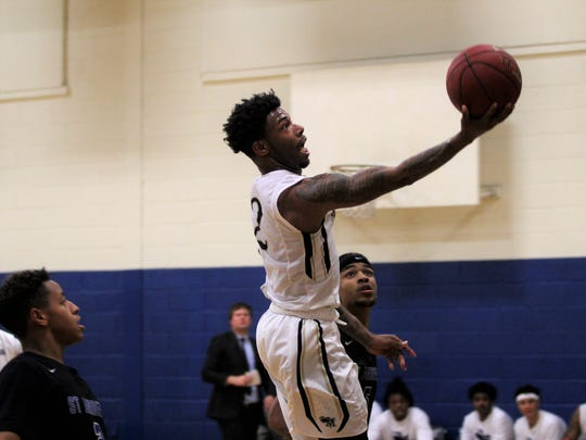 Jalen White drives to the hoop in the second half of the Montreat Cavalier's ninth straight victory on Nov. 21 against St. Andrews University.