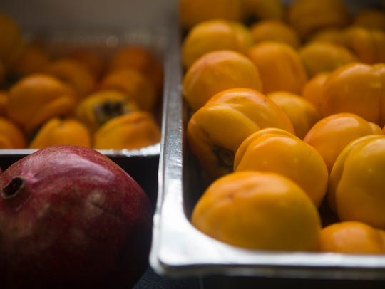 Persimmons used for making mead at Liquid Alchemy Beverages near Elsmere.