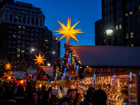 Evening is a special time to visit the Christmas Village in Love Park.