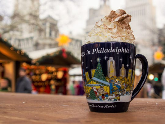 Hot cocoa in a Christmas Village keepsake mug keeps the winter chill away.