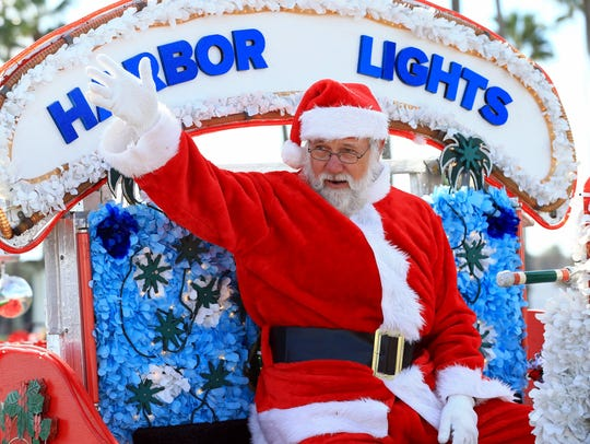 Santa Clause waves during the Harbor Lights Festival