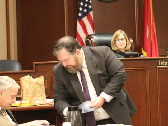 Assistant District Attorney Daniel Stephenson shows