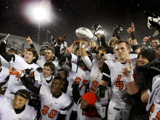 The Loveland football team beat Cleveland Glenville 41-23 in the Division II state final on Dec. 6. It was the school?s first OHSAA state football title. The Enquirer/ Joseph Fuqua II OHLoveland1207 Sports Friday December 6, 2013: Loveland team gestures number one as they celebrates after Loveland beat Cleveland Glenville in the 4th quarter. Loveland High School battles Cleveland Glenville High School in Division II state Championship football game at Fawcett Stadium Friday December 7, 2013 in Canton, Ohio. Loveland won 41 to 23 over Cleveland Glenville. The Enquirer/ Joseph Fuqua II