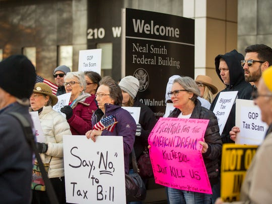 Protesters gather outside the Neil Smith Federal Building