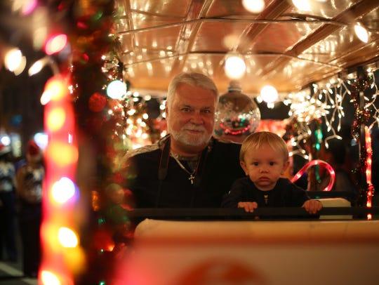 Joe Goeke and his grandson Brantley Peters,  sit in