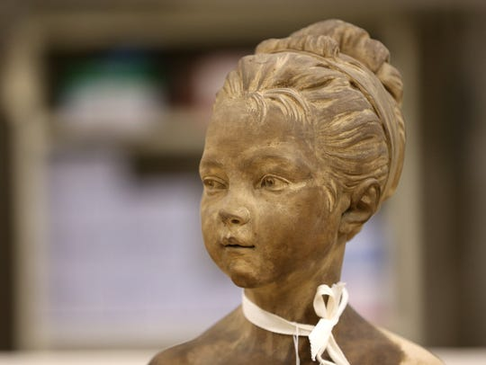 A bust in storage  at the Memorial Art Gallery that