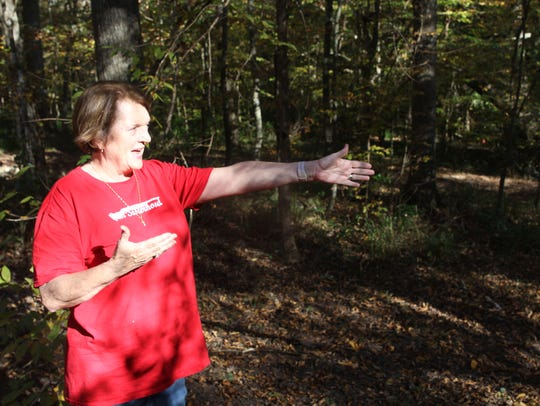 "Eve Haney points out a ravine which acts as a berm for target practice on her property off Timberlane Road. Neighbors have complained about gunfire on the 17-acre parcel. ""I only want safety,"" she said. ""I'm really strict about our rules down there."""