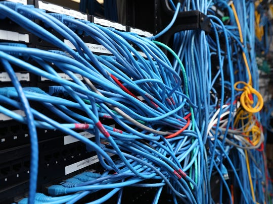Network cables are plugged in a server room in New York City.