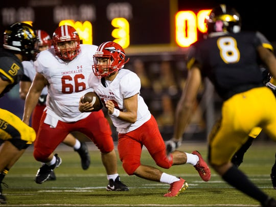 Immokalee quarterback RJ Rosales carries the ball against American Heritage School in the second half of action during the Class 5A State Semifinal at American Heritage School Friday, Dec. 1, 2017 in Plantation, Fla. Immokalee lost 28-21 ending their season.