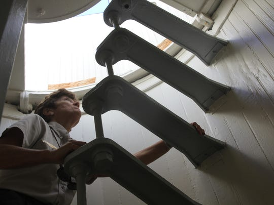 St. Marks National Wildlife Refuge Ranger Robin Will climbs the stairs of the St. marks Lighthouse.