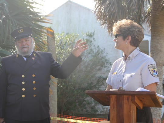 St. Marks National Wildlife Refuge Rangers Robin Will, right, and Craig Kittendorf talk about the lighthouse's history.